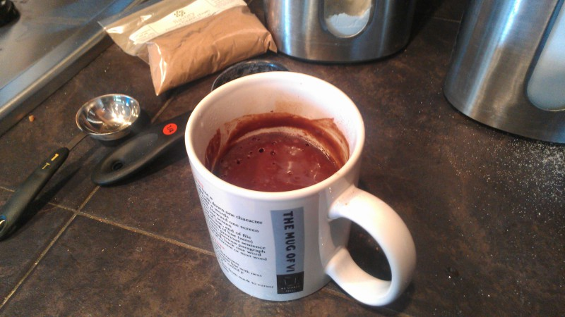 Partially cooked brownie in a mug